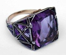 Sibyl Dunlop. An Arts and Crafts ecclesiastical ring made for Arthur Winnington-Ingham, Bishop of London from 1901-39. It is fashioned from various triangular amethysts set within pierced and foliate engraved millegrain mounts.