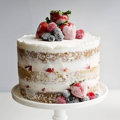 how to make a simple naked cake with fresh berries and buttercream filling. This cake is perfect for summer with it light flavors and fresh sugared berries