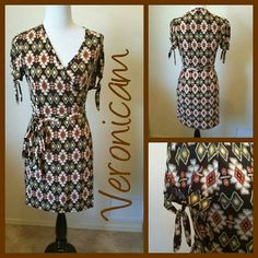 VERONICAM AZTEC WRAP DRESS 96% polyester, 4% spandex.  Dress wraps and ties.  Tag says large, runs medium.  Displayed on size 6 mannequin. Veronicam Dresses Midi