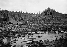 "Caption:"" 1940 WW2, London Docklands. The German bombing of England was more frequent and cities and towns up and down the country were beginning to witness nightly attacks. Here we see Docklands terrace housing area where bombs have completely destroyed a street, total destruction."""