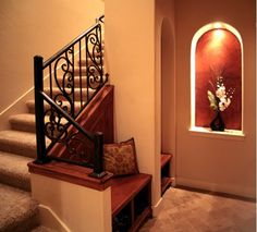 Thoughtful stairs. Love the bench and arch area vs the long weird closet area underneath