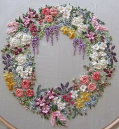 Garland of silk ribbon flowers embroidery.