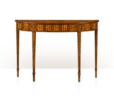 A mahogany, rosewood and parquetry inlaid demi-lune console table, with fan inlaid top, faux fluted frieze and oak lined drawer, on bellflower inlaid square tapering legs. The original George III, Dublin. Attributed to William Moore, circa 1780. From an Irish Private Collection.