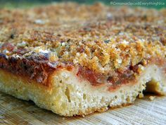 Sfincione is a cheeseless Sicilian Pizza... but the crunchy breadcrumb topping is just gorgeous! I'd kill for this!