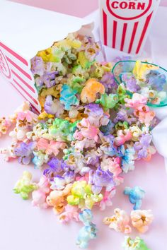 This homemade rainbow popcorn is both beautiful and delicious, and it's light and airy with no butter needed! This easy light popcorn recipe will quickly become your favorite, and it's even better sprayed with a rainbow of colors. Rainbow Popcorn, Rainbow Snacks, Rainbow Food, Rainbow Sweets, Rainbow Pastel, Rainbow Baby, Girls Birthday Party Themes, Unicorn Birthday Parties, Girl Birthday