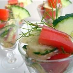 Crispy cucumbers, fresh tomatoes, and onion add spark to this simple summer salad. - just leave out sugar