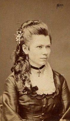 1870's lady; gorgeous hair!