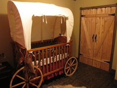 Covered wagon crib... wonder if Alishia would go THIS country for her little cowboy/cowgirl nursery?!