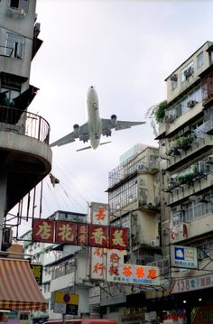 Plane flying over residential buildings before Kai Tak Airport was closed down, Hong Kong, China