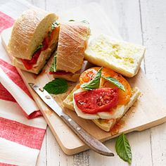 Nothing says summer like ripe heirloom tomatoes in a Caprese salad. Even better: Put the same ingredients on a roll so the bread catches all the juices.