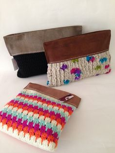 Crochet clutches love the look of the crochet bottom and the fabric around the top