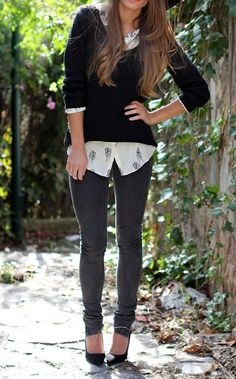 Black sweater over a white collared shirt + charcoal skinnies