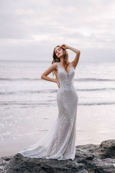 This Ariel-inspired gown is playful, yet elegant. A subtle flared train is reminiscent of a mermaid's silhouette, while sparkling sequins mimic the play of light across the moonlit sea. Disney Wedding Dresses, Wedding Dress Sizes, Designer Wedding Dresses, Disney Weddings, Gown Gallery, Bridal Gallery, Bridal Gowns, Wedding Gowns, Wedding Bells