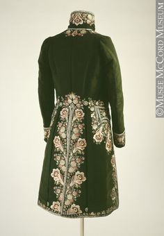 Rear view, frock coat, c. 1795. Splendid dark green uncut velvet, heavily embellished with rich multi-coloured floral embroidery.