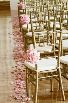 I'll have rose petals along the aisle runner and have white bows hanging from chairs with blue tulle draped in-between.