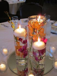 this is really pretty and i have been contemplating having a few different options for the tables, not all the same! have purple and fuschia, blue and hot pink, purple and orange.
