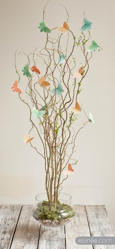 Make a statement for your next gathering with this Twig & Butterfly Centerpiece! Tutorial to create yourself!
