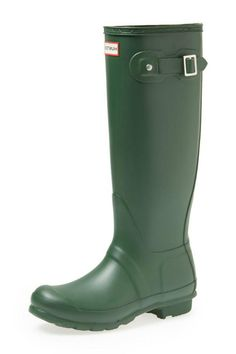 """A classic finish perfects a puddle-proof rubber boot finished with a traction-gripping sole. Subtle tonal motifs circle the shaft while an adjustable buckle at the side adds interest. 1"""" heel height; 16"""" boot shaft height; 14 1/2"""" calf circumference. Half sizes should size down.  Original Tall Boot by Hunter. Shoes - Boots - Rain and Cold Weather New York"""