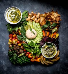 The MOST gorgeous Thai-inspired Crudité Platter from @whatdoyoucrave's Yai's Thai Instagram takeover, perfect for a #neverbland holiday! This amazing snack spread includes: >Thai Chili Lime Hummus >Greek Yogurt with Spicy Thai Relish Chimichurri >Thai Chili Garlic Hot Sauce Infused Goat Cheese >Thai Chili Garlic & Chili Lime Shrimp Wontons >Chili Lime Sauteed Mushrooms >and all these beautiful fresh and roasted veggies!