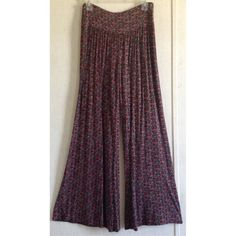 Lucky Brand Floral Palazzo Pants Excellent condition! Little to no wash wear. Super cute Lucky Brand palazzo pants. Floral pattern of maroon, blue, and black. Wide legs with bell bottom openings. Wide waistband. Super soft stretchy fabric. 14 inch rise. 32 inch inseam. Size small. +All offers welcome Lucky Brand Pants Wide Leg