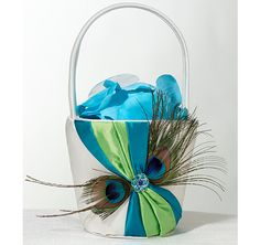 The Peacock Flower Basket will complete the look of your peacock wedding theme!