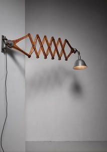 A rare version of the classic Triplex wall lamp, designed in 1919 by Swedish inventor and designer Johan Petter Johansson. Originally designed for industrial use, but later also applied in residential projects.  The large scissor extension makes this a unique piece. Extendable to 210 cm / 83 inch. Dimensions of theshade: 57 cm high x 24 cm diameter. The depth folded in: 70 cm. Depth extended: 210 cm