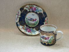 Antique coffee can and saucer by Goode