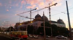 The sunset over the cranes over the National Museum and the highway