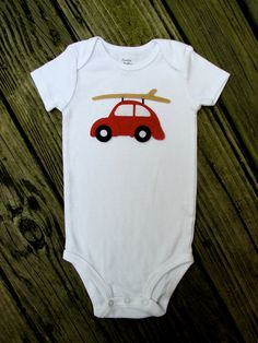 Punch Buggy Surfer Car Baby Shower Onesie. $22.00 USD, via Etsy.