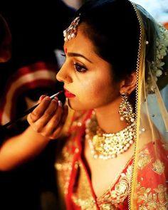 Making of a Bride.. #indianbride #indianwedding #candidweddingphotography #brideportraits #smokeyeyes #kohleyes #falselashes #redlips #gajra #redbindi #indianjewellery #anjumbhardwajmakeup #makeupartist #makeupartistcommunity #lovemyjob http://ift.tt/1r2ISvM by anjumbhardwajmakeup