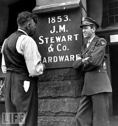 Jimmy Stewart with his father in front of the family business in Indiana