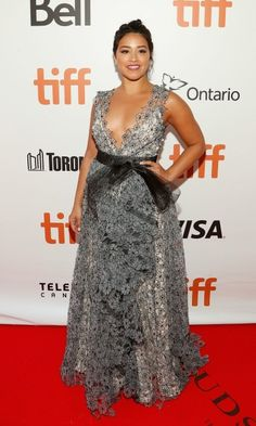 Gina Rodriguez took over the red carpet in a lfloral print Badgley Mischka gown during the premiere of Deepwater Horizon at the Toronto International Film Festival.
