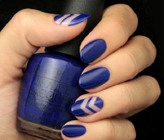 Simple yet funky looking dark blue nail art design. The blue nail polish is further designed by adding clear nail polish that shows successive v-shapes on a few of the nails making it look great.