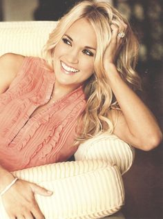 carrie underwood. Shes a christian and that makes me like her even more!