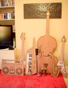... some cardboard props for their wedding day, in the shape of musical instruments so that they and their guests could play air-music into the night.