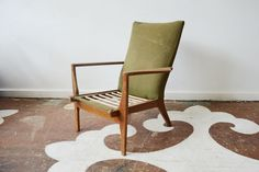 Vintage Danish modern armchair with lovely period lines. This chair is structurally sound, but needs refinishing and reupholstery. It will be a stunner when redone.    $0.00 to Adopt!     $575.00 to reupholster   5 yards fabric needed   $275.00 to sand and refinish