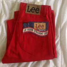 Vntg 1980s red straight leg LEE jeans.  Long Adorable high waisted  jeans look very cute with the red striped crop top in my shop.  Still have tags on.  LEE brand.  May smell musty due to storage. Vintage Jeans Straight Leg