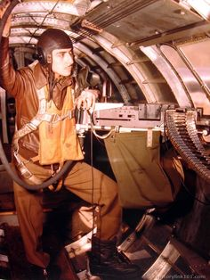 Royalty Free Pictures of World War II . B17 waist gunner in A-11 helmet, A-2 jacket, B-4 life vest (mae west)  and B-8 parachute harness.
