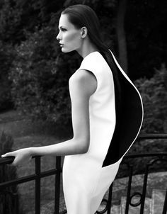 3D contoured dress back design with sculptural silhouette; bold monochrome fashion construction // Jil Sander