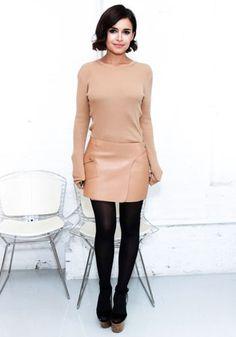 Miroslava Duma in a tan sweater + tan leather miniskirt + black tights + black heels