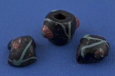A group of 'eye beads', a form very popular with the Norse, and found on Viking sites in Man, Ireland, Orkney and across Scandinavia.  Source:  The Whithorn Trust.
