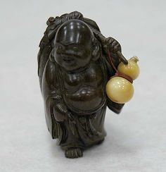 Netsuke of Hotei with Bag and Gourd 19th century