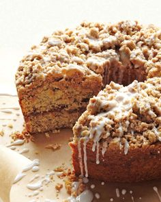 """Everyone needs a delicious coffee cake recipe in their repertoire, and this cinnamon streusel coffee cake recipe is the perfect option. Meaning """"something strewn"""" in Old German, streusel is easy to throw together -- and then to throw on top of this sour-cream coffee cake. The sweet glaze in the recipe is the perfect coffee cake topping."""