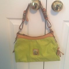 "Lime green nylon Dooney & Bourke small bag Lime green nylon Dooney & Bourke small purse. In excellent condition. 100% authentic. 12"" x 7"" Dooney & Bourke Bags"