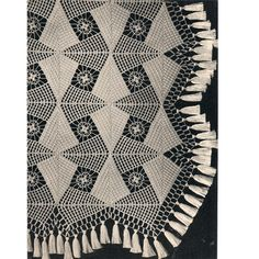 Spearhead Crocheted Bedspread Pattern, No 806.  This spread is a distinct beauty. Crocheted in interesting offside blocks with a central cluster motif, the blocks, full and half are joined in such a manner as to give a geometric effect. The edges are finished with the half motifs, double lace border and full row of long tassels.