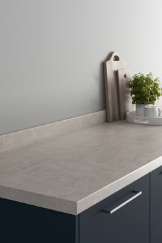 Looking for stone countertops ideas? Our Howdens Biancostone Laminate Worktop looks amazing when paired with a black slab kitchen and chrome kitchen hardware. These grey stone effect kitchen countertops are affordable and are perfect for creating texture in your modern kitchen design. Howdens Worktops, Kitchen Worktops, Kitchen Hardware, Stone Countertops, Work Surface, Work Tops, Grey Stone, Modern Kitchen Design, Floating Nightstand