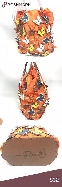 Jessica Simpson butter fly bucket bag Beautiful butter fly bucket bag very roomie in great condition small defect on the handle. Has a dray string closure.   FYI 📌📌📌📌📌 Things to keep in mind when shopping my closet  ✔️  all item come from a smoke free pet free clean home ✔️ all items shipped same day or next day unless its Friday orders will go out Monday  ✔️ open to offers I do not use the private offer system  ✔️ discounts on bundles  ✔️posh ambassador Jessica Simpson Bags Totes