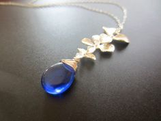 Trio Orchid Cascade Sapphire Necklace. Sterling Silver Necklace. $36.00, via Etsy.