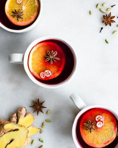 This Cranberry Cider recipe is deeply fragrant with sweet spices like cardamom, ginger, star anise, and cinnamon.  These spices give the cider a rich flavor and fantastic aroma.  Serve it hot garnished with a slice of orange. - #holisticnutrition #christmasrecipe #nourishedkitchen