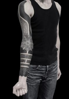 Creative heavy black tattoo sleeve -- useful for cover-ups